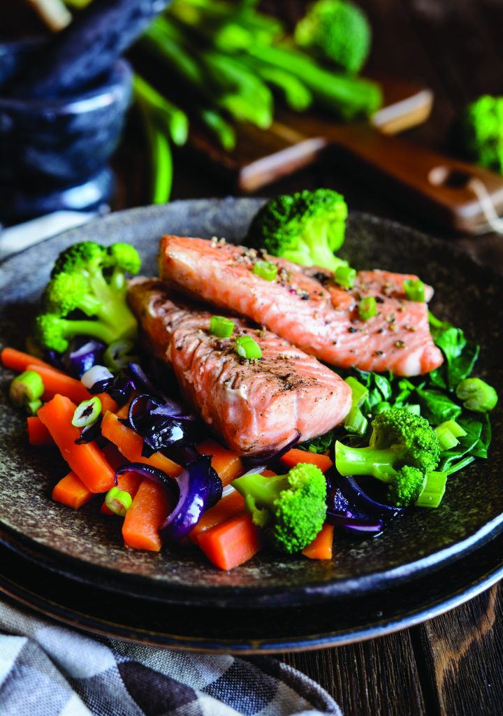 Image of a meal you may learn to cook during Intensive Cardiac Rehabilitation-image of salmon on a bed of vegetables